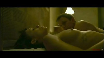 Mainstream fuckfest and bareness from the movie The female With The Dragon Tattoo.  forced fellatio (non explicit), corded down on bed, lesbian sex, non graphic fucking.