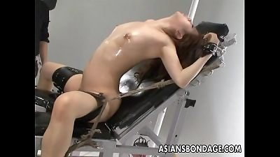 Nasty Asian whore in bondage gets her muff teased